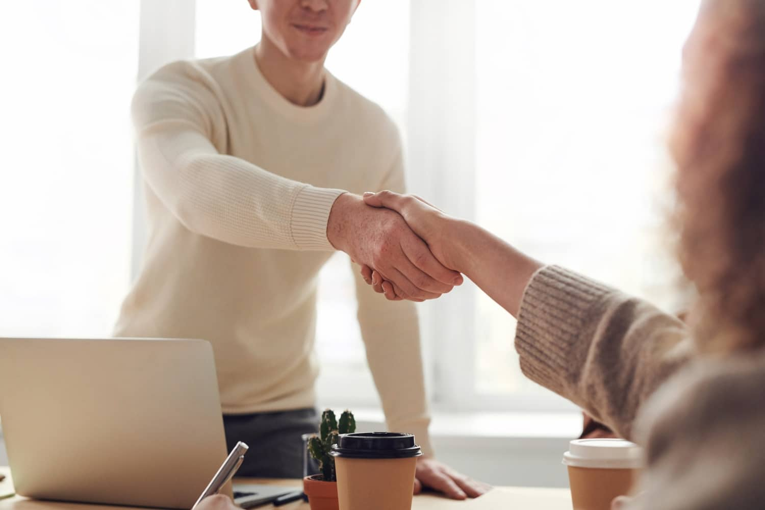 Handshake with your first non-family employee